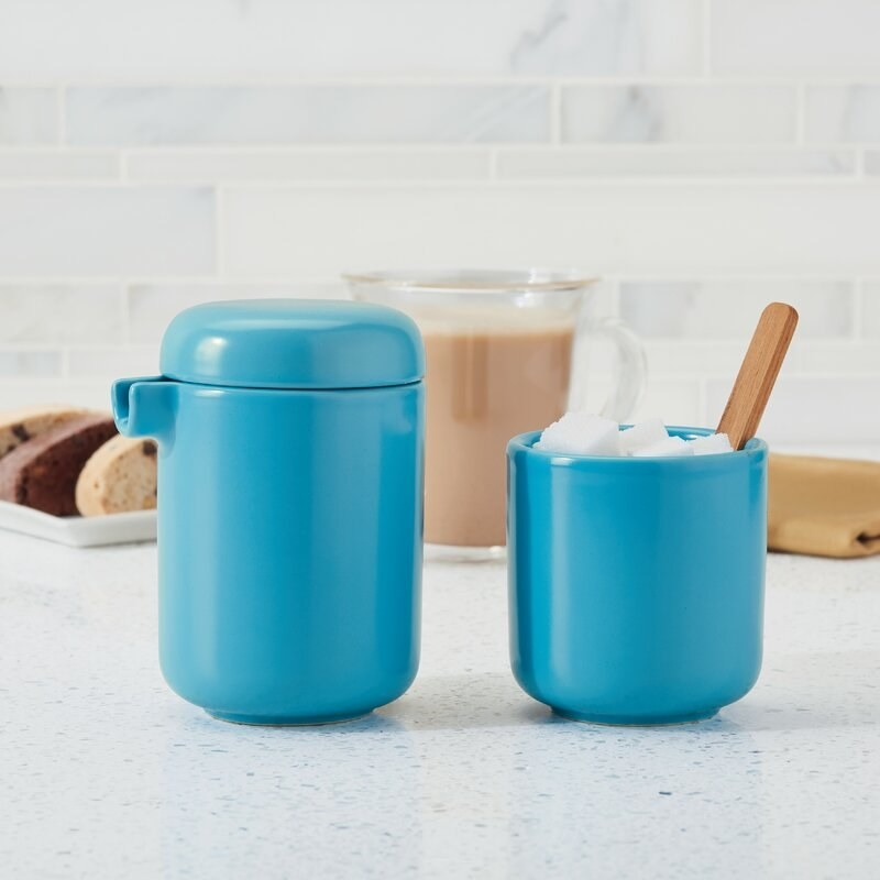Light blue ceramic sugar and creamer set on a table