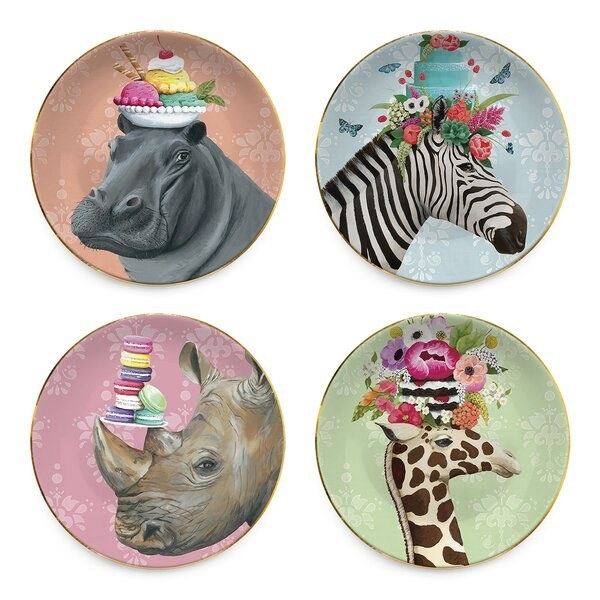 Four plates featuring illustrations of a zebra, a giraffe, a hippo, and a rhinoceros — posing with desserts