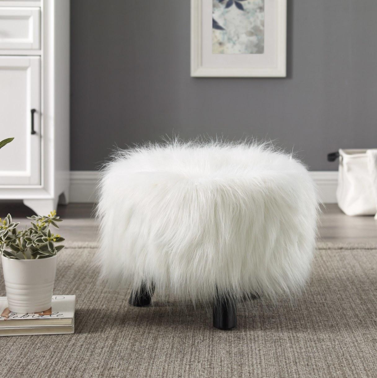 The white fuzzy stool
