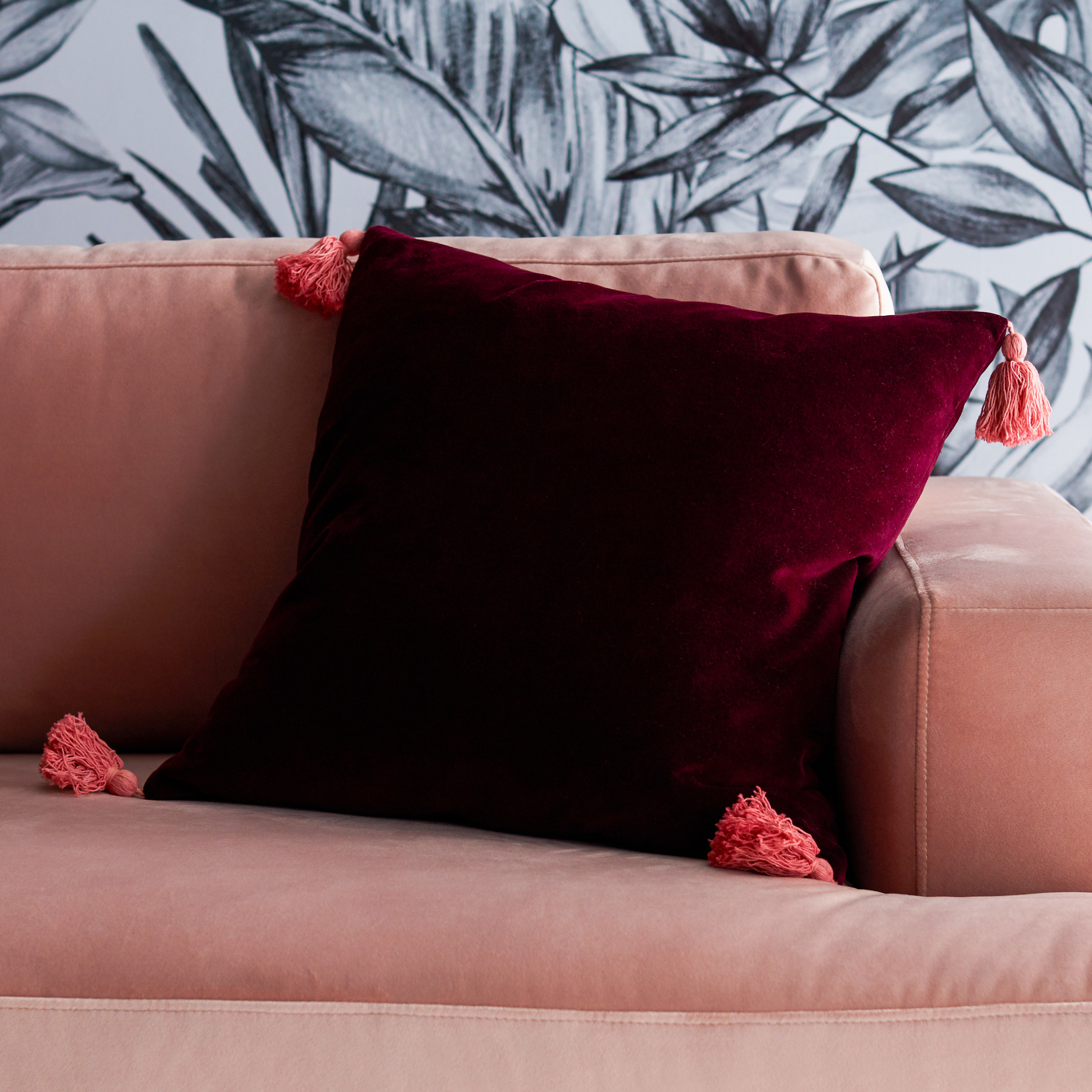 The red pillow on couch