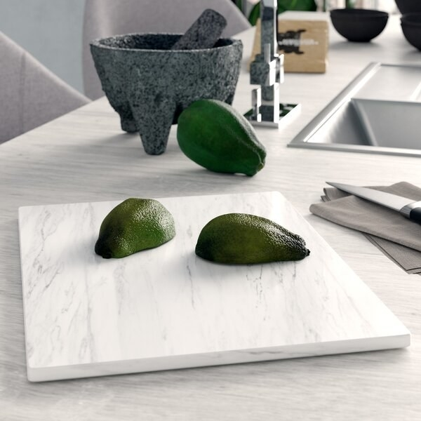 A rectangular, light marble colored cutting board