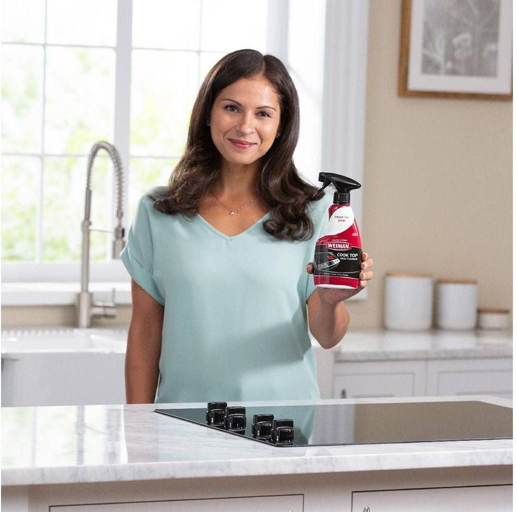 Model holding bottle of product
