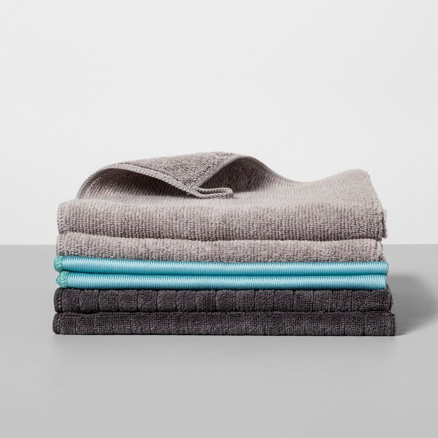 Stack of gray, blue, and charcoal dust cloths