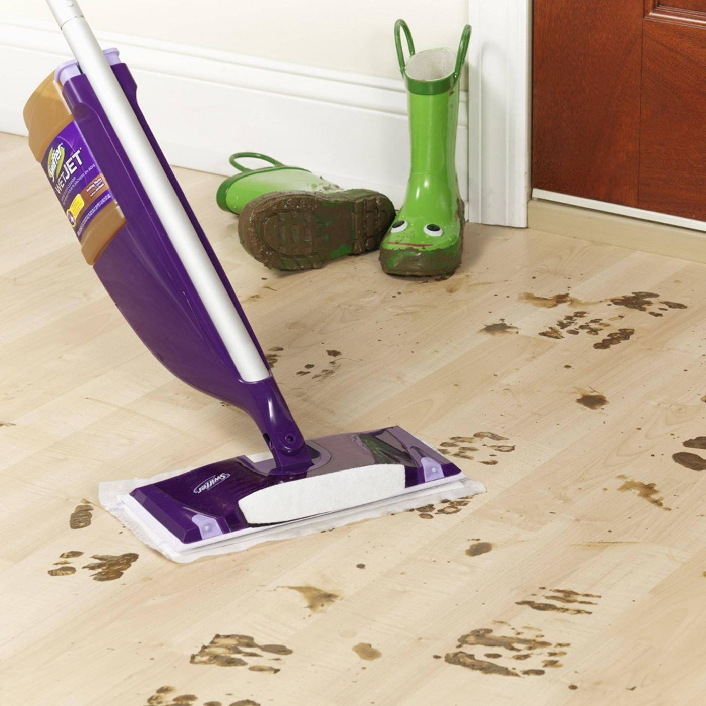 Mop cleaning up dirty floor