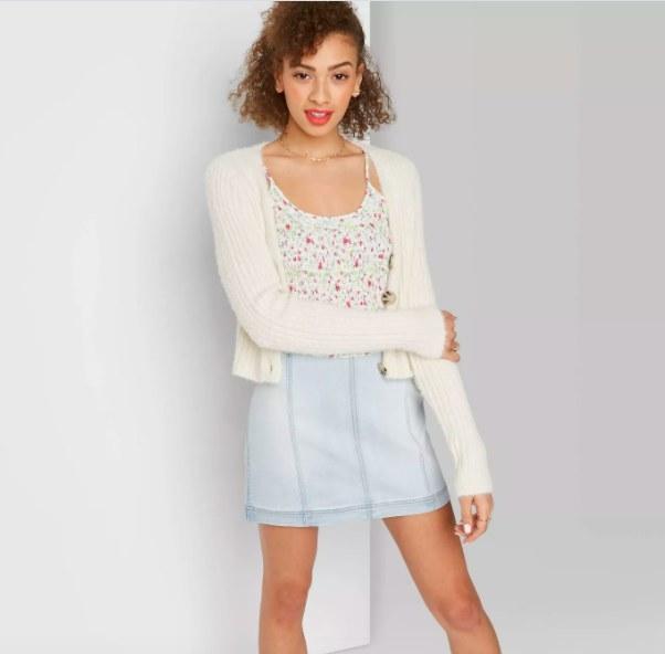 Model wearing the light wash denim skirt