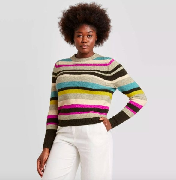 Model wearing the multi-colored striped sweater