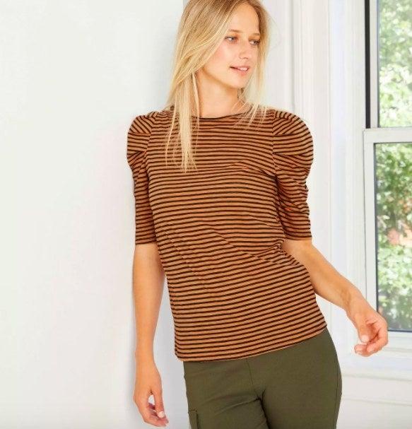 Model wearing  the brown top