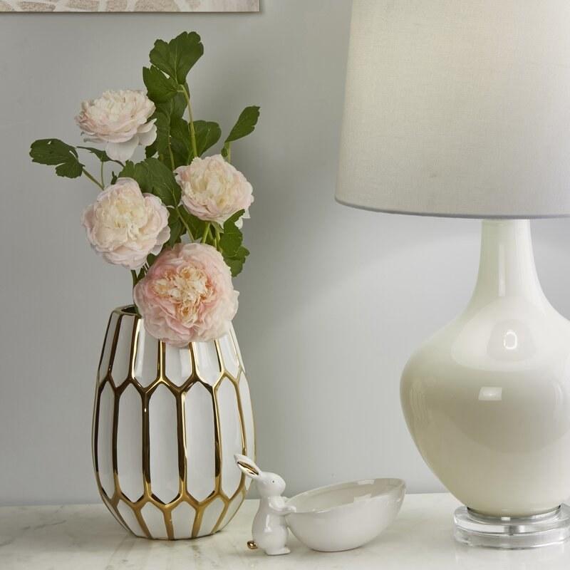 A gold-accented hexagonal vase