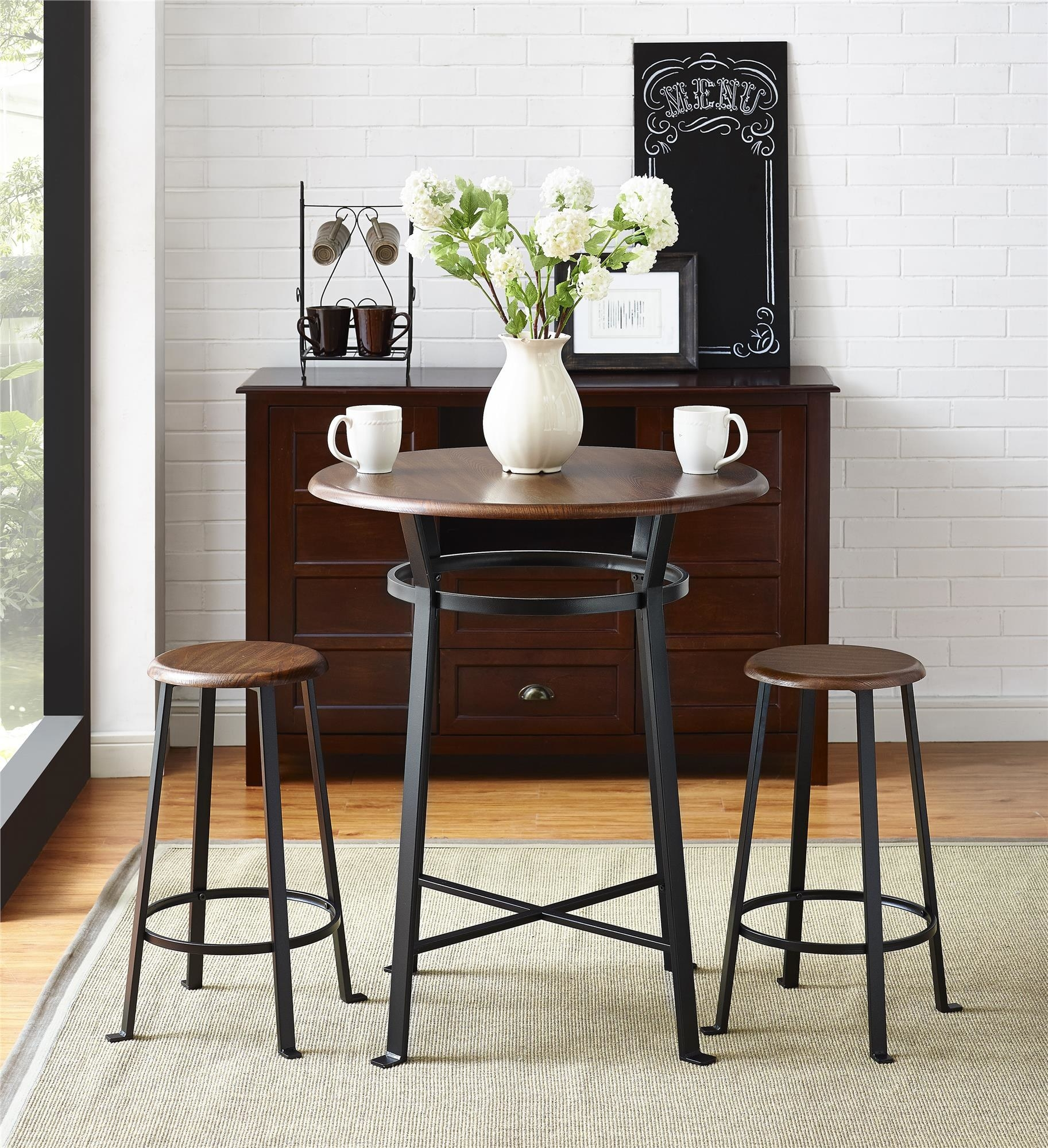 The black and brown table and chairs