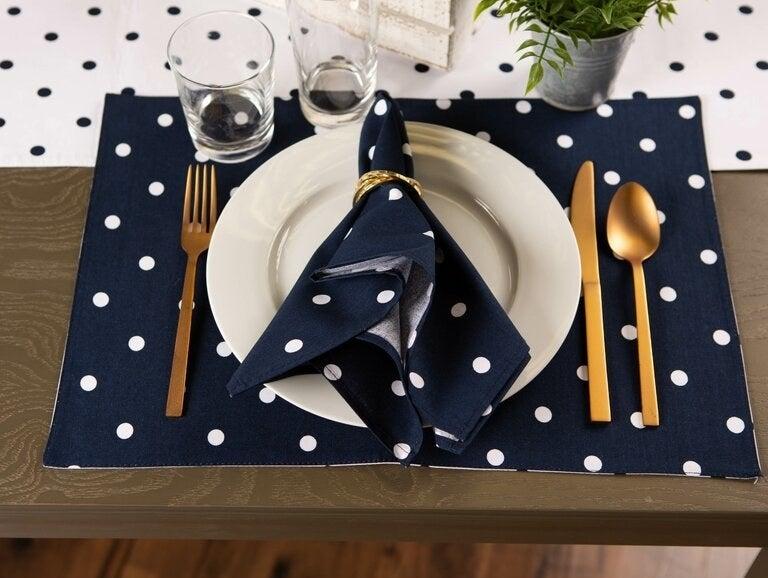 A navy blue napkin with white polka dots