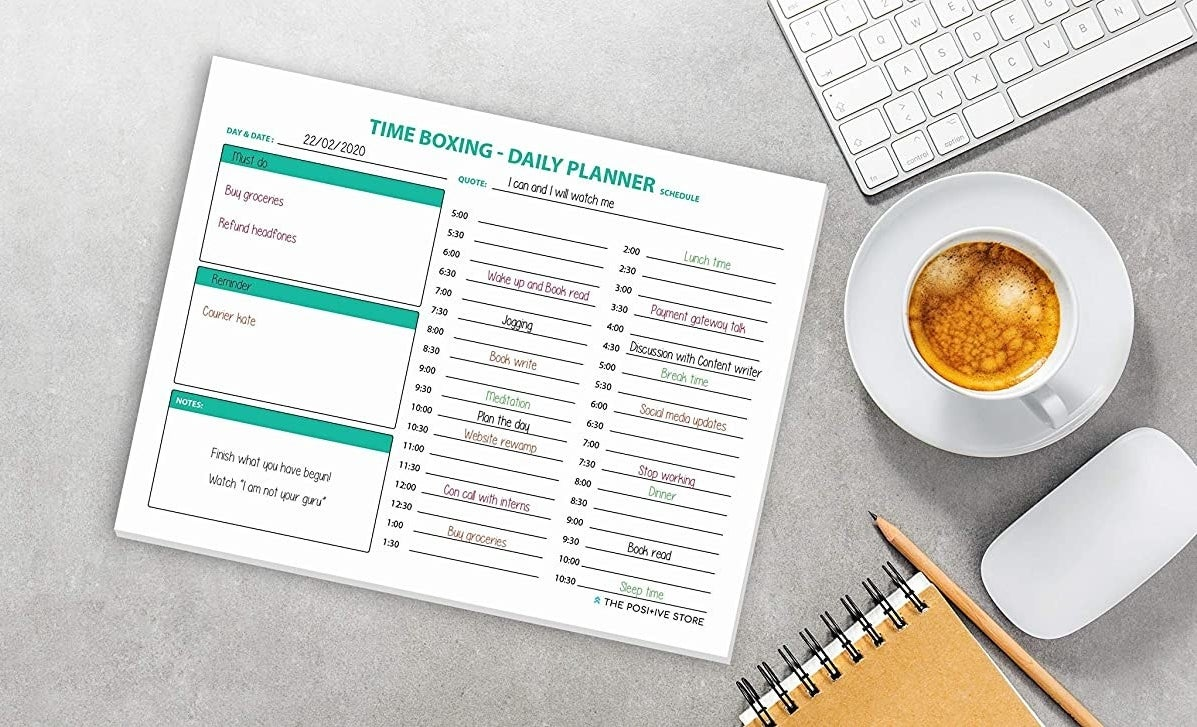 Image of the planner on a work desk, with filled in times of the day, to do list, notes, etc.