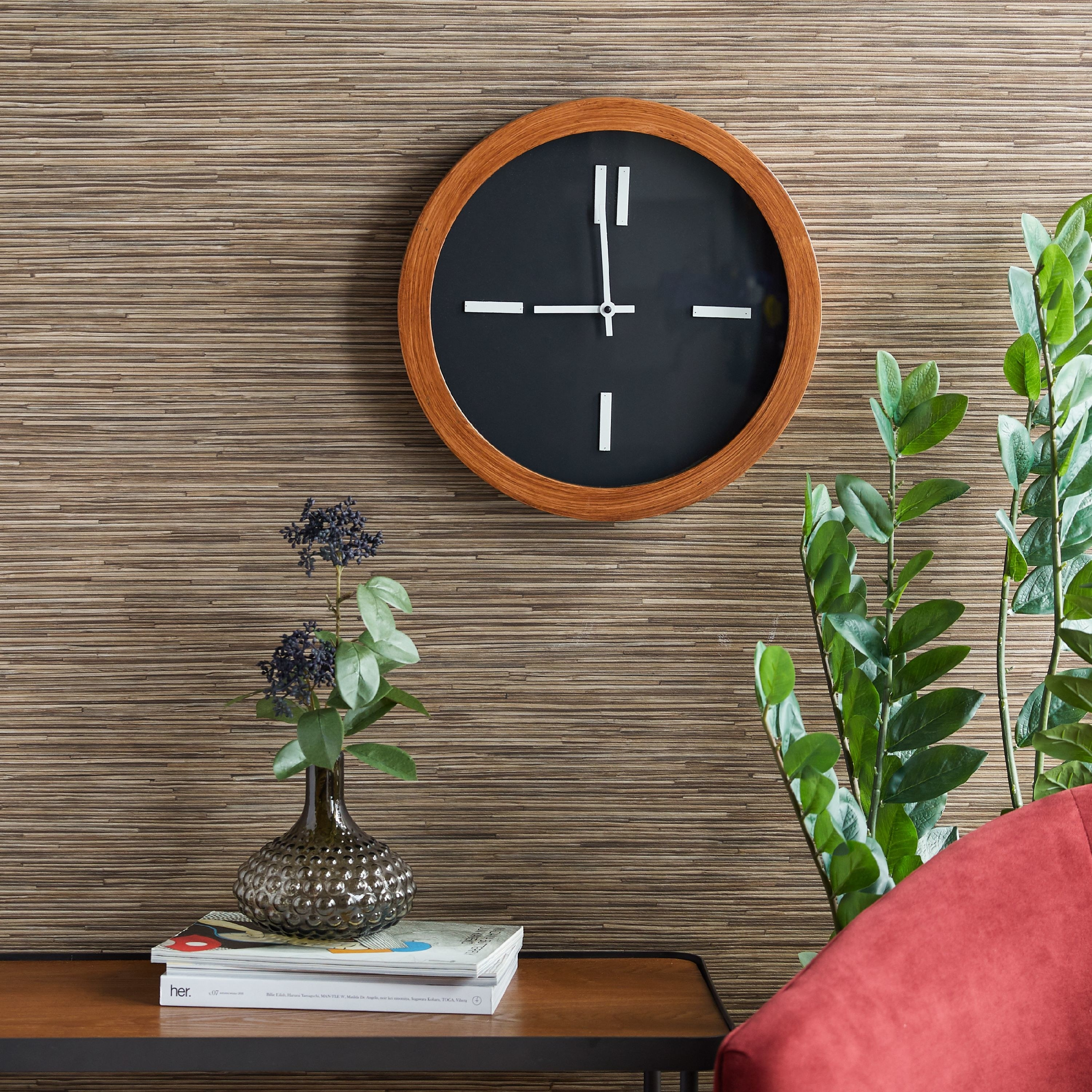 The brown and black clock hanging