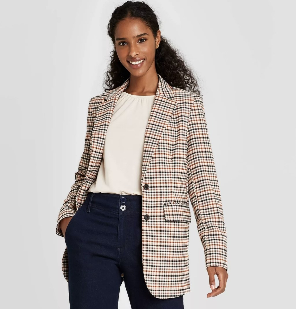 Model wearing the plaid blazer