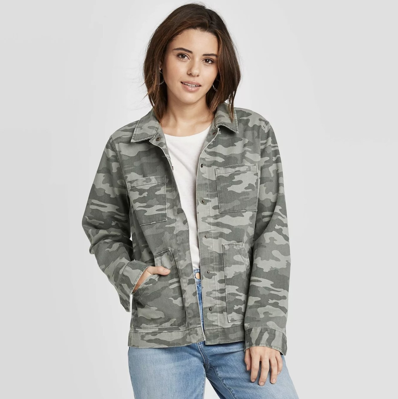 Model wearing the camo jacket