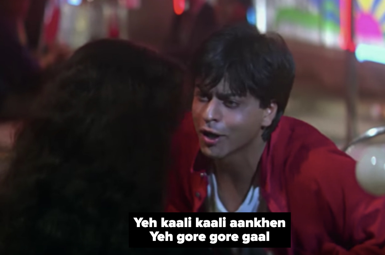 shah rukh khan sings to kajol in a still from the movie baazigar