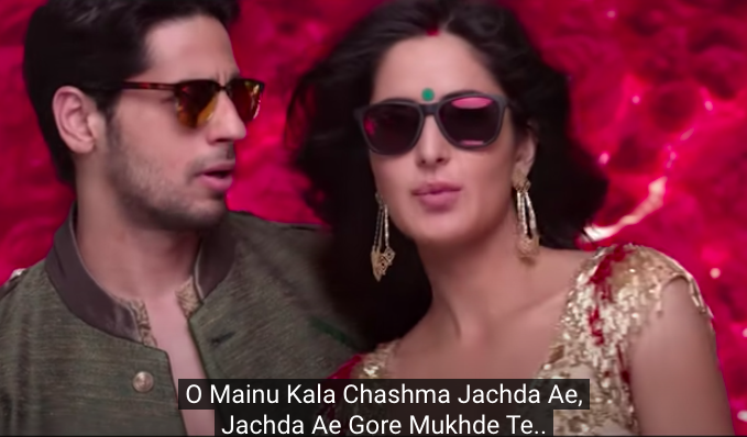 clad in black sunglasses, sidharth malhotra looks at katrina kaif as they dance to the song kala chashma
