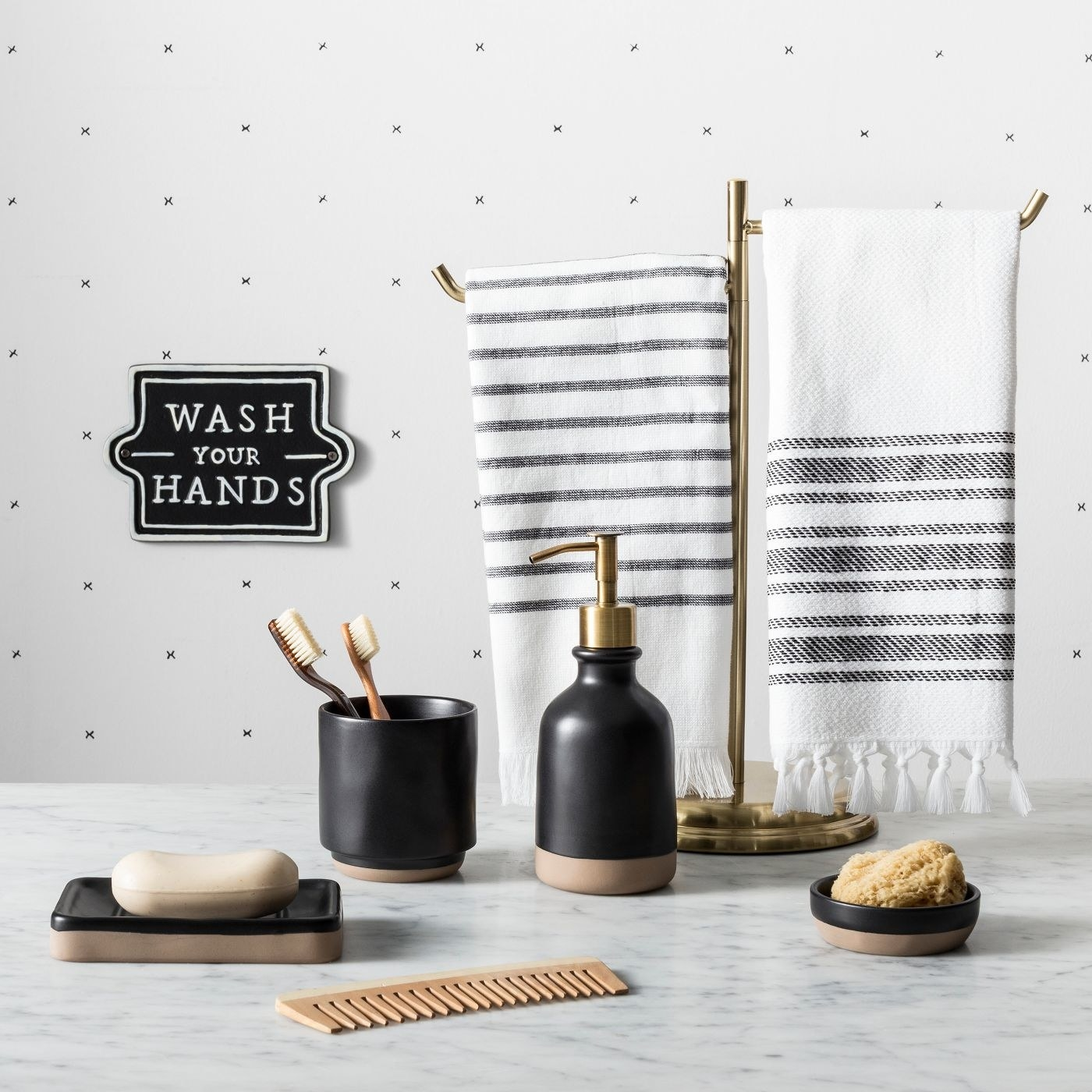 The black and white 'Wash Your Hands' sign hanging on the wall