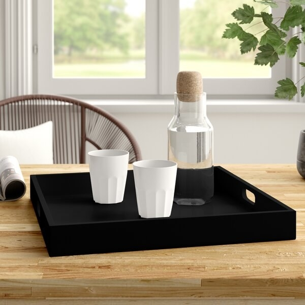 A black wooden serving tray