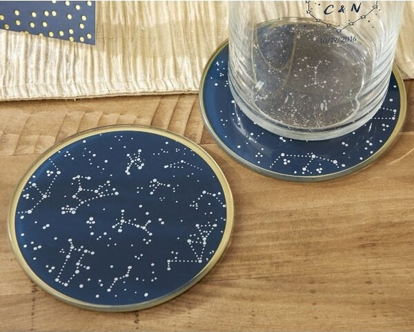 Blue coasters with gold trim set on a table
