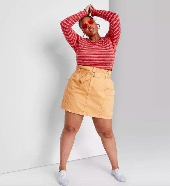 Model wearing the tan skirt