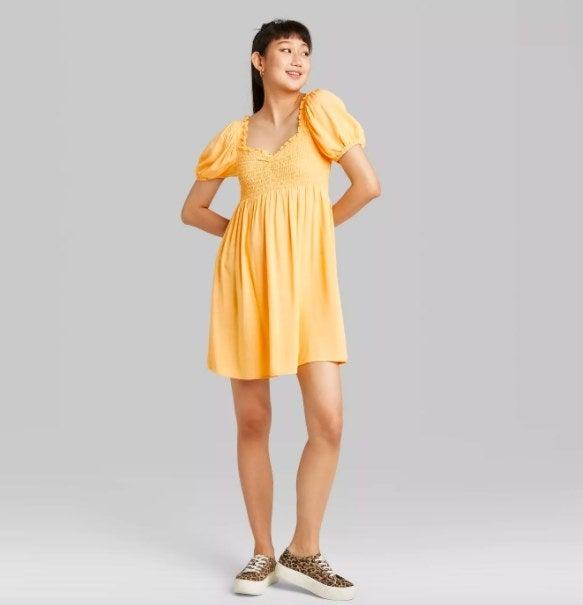 Model wearing the yellow dress