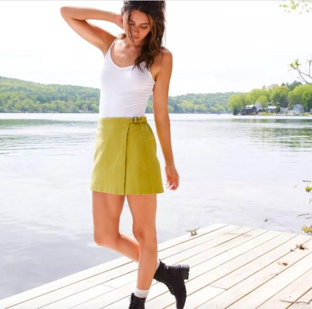 Model wears the yellow skirt