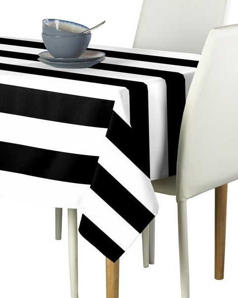 A tablecloth with wide black and white stripes