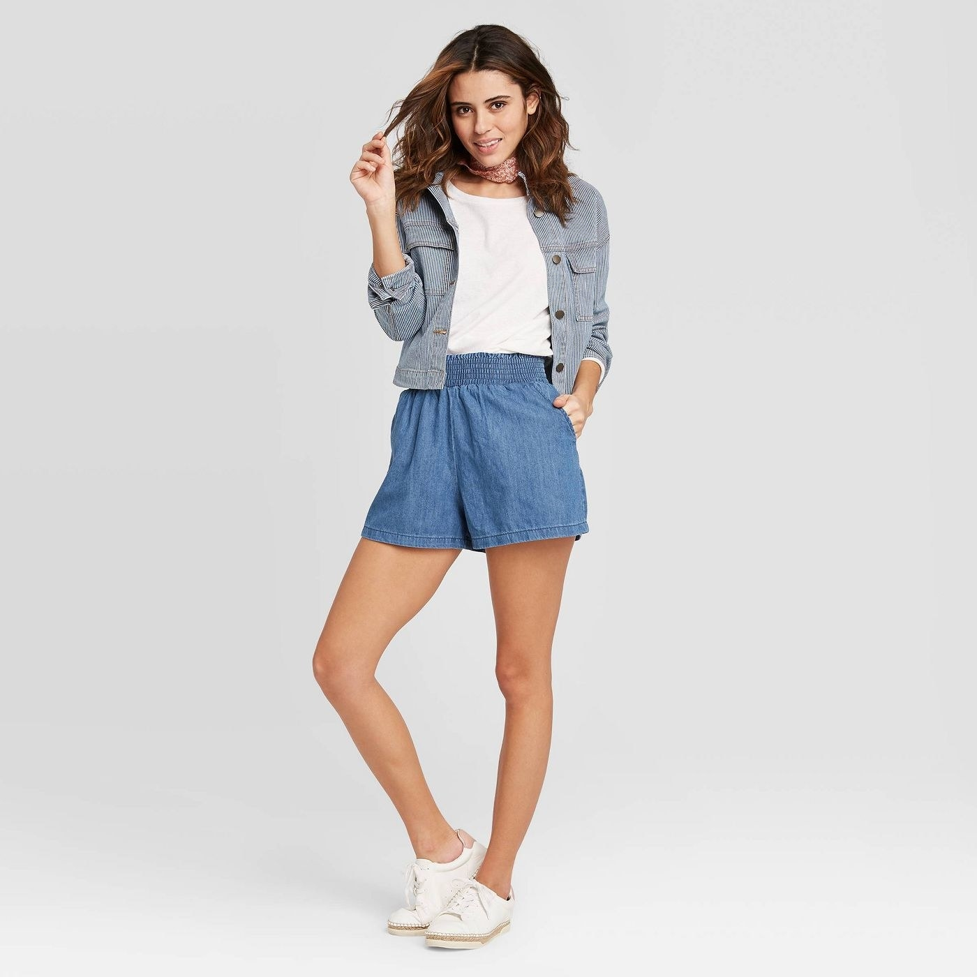 Model in pull-on denim shorts