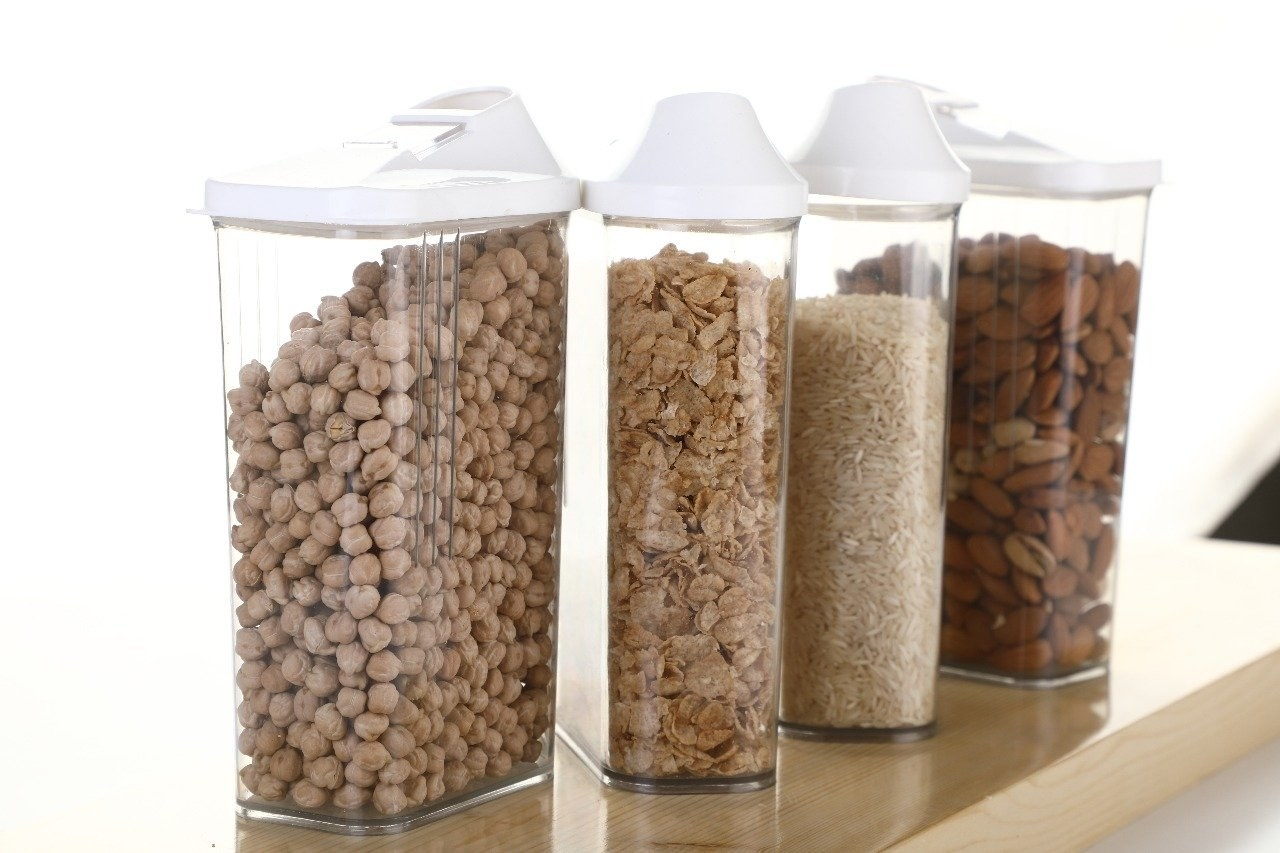 Chickpeas, cereal, rice, and almonds stored in four different containers