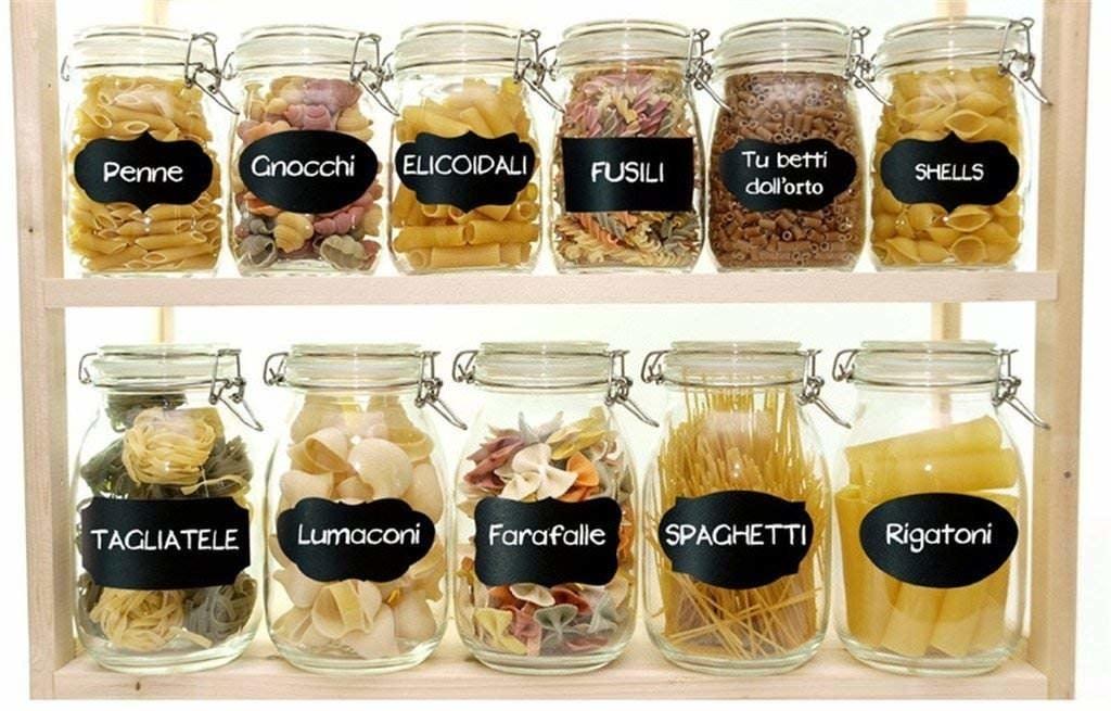Chalkboard stickers labeling different pasta types like penne, gnocchi, spaghetti, farfalle etc.