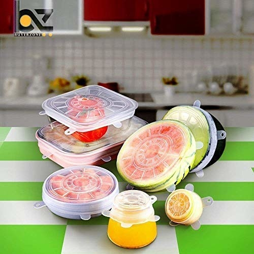 Several containers and half-cut fruits covered with silicone lids.