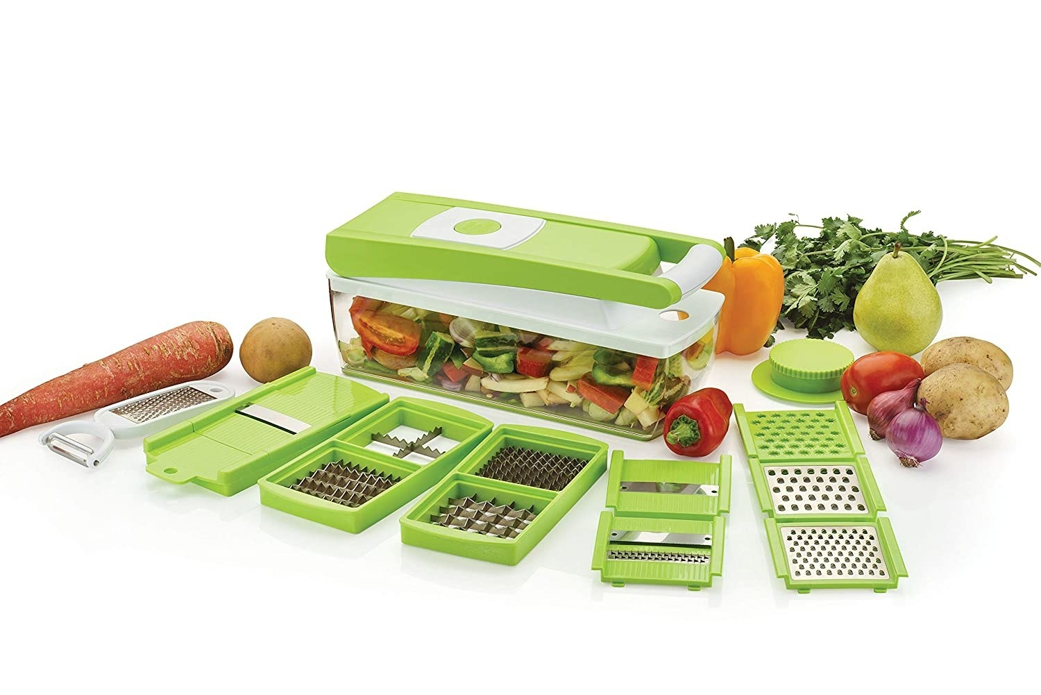 A flat lay of the 15-in-1 kitchen tool with all the different types of chopping, cutting, dicing and grating plates and a selection of vegetables.