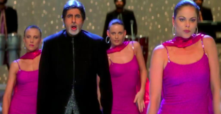 amitabh bachchan dances, with several other background dancers, to the tunes of shava shava