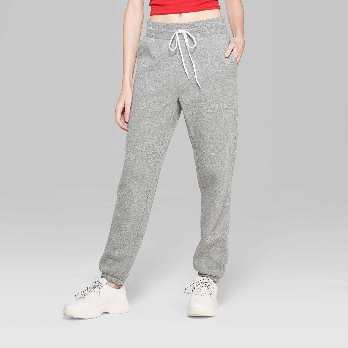 Model in gray sweatpants
