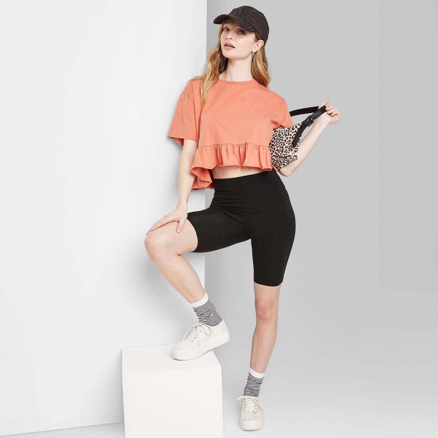 Model in black bike shorts