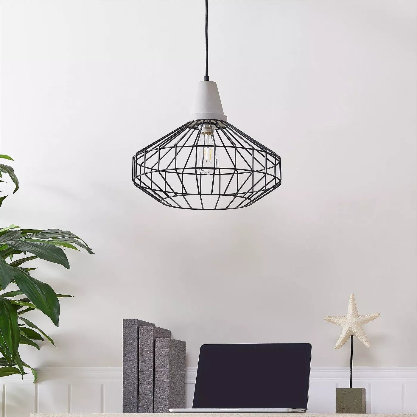 The pendant lamp with a black cage shade