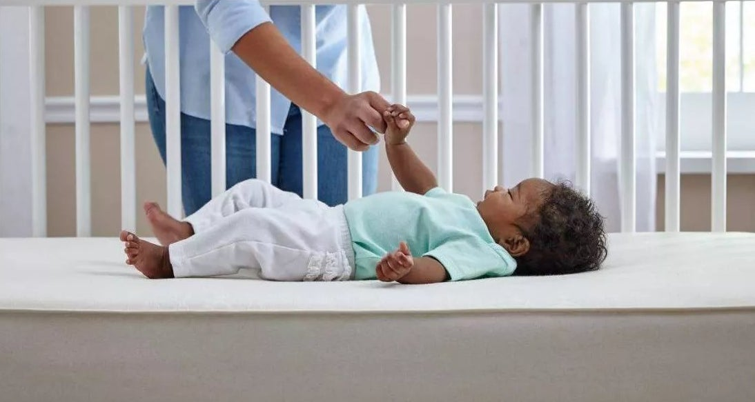 A baby on the mattress