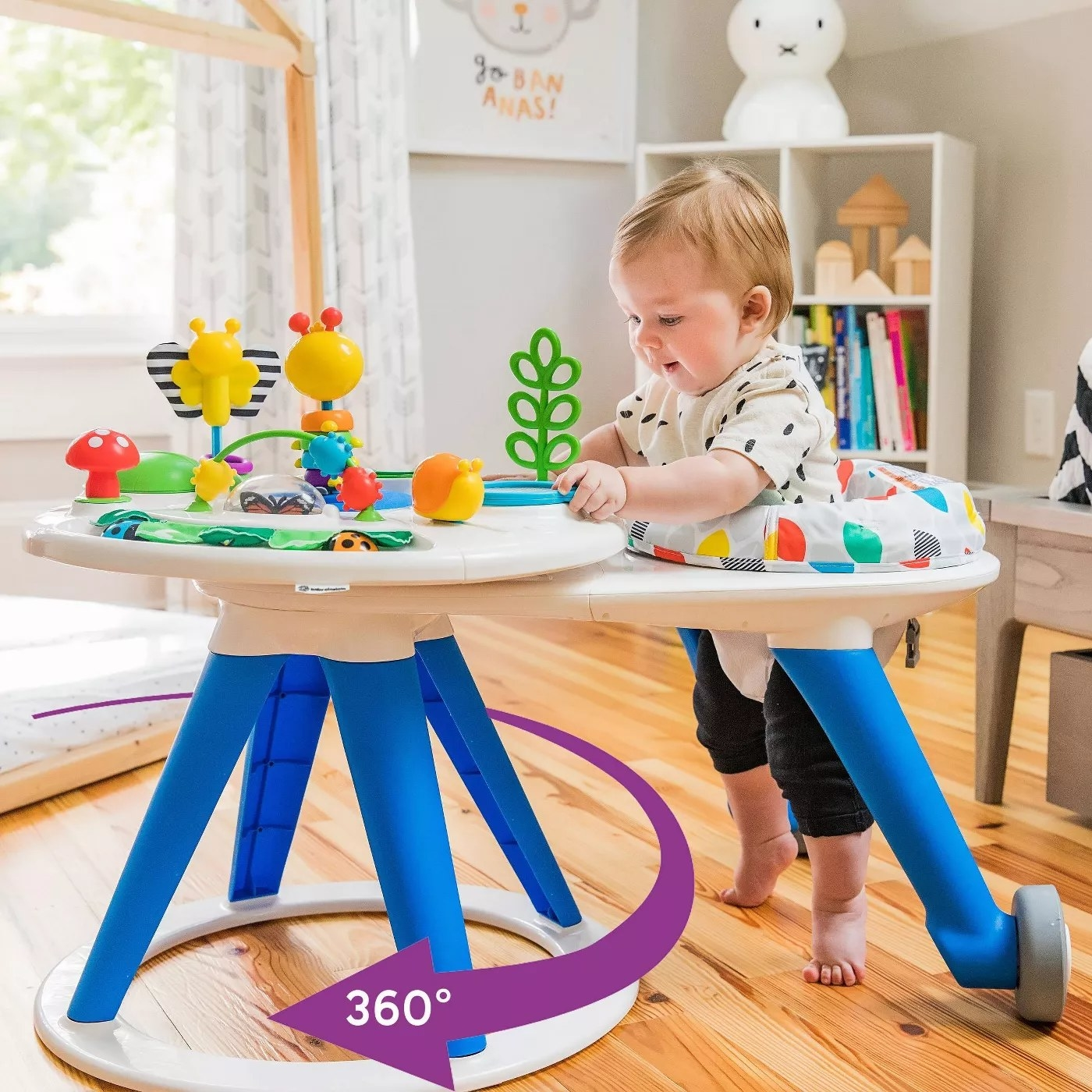 A baby in the activity center which can rotate 360 degrees