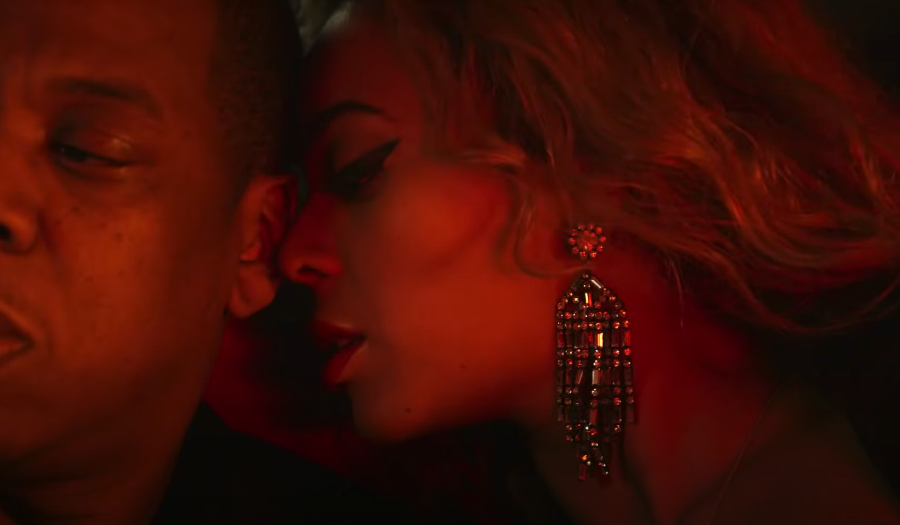 """Jay-Z and Beyoncé in the backseat of a car in the """"Partition"""" music video"""