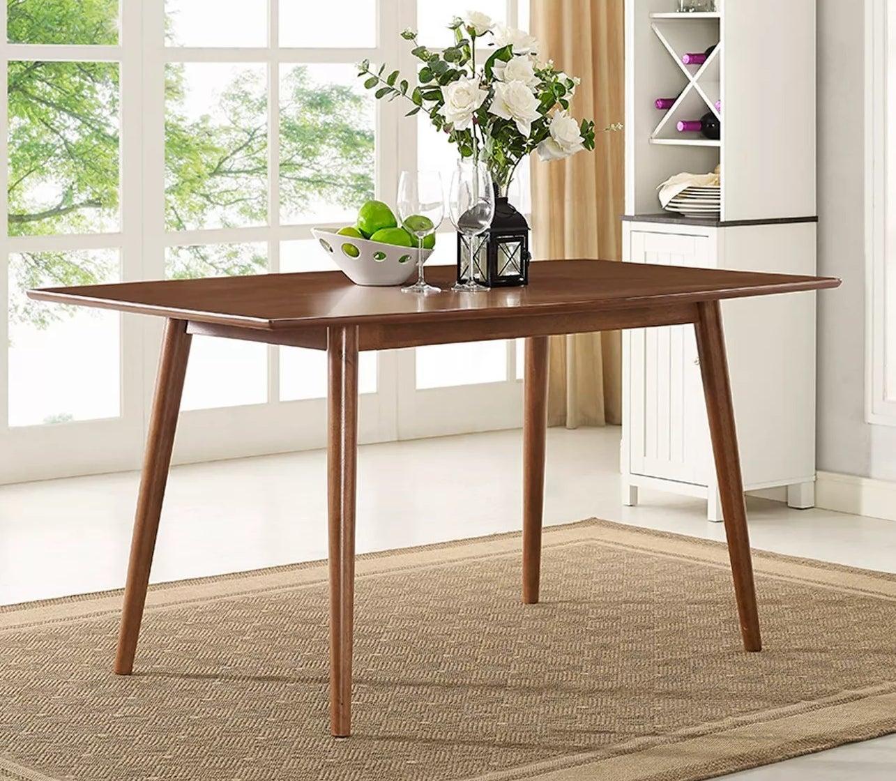 The dark wood table