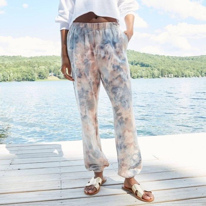 Model in tie-dye sweatpants