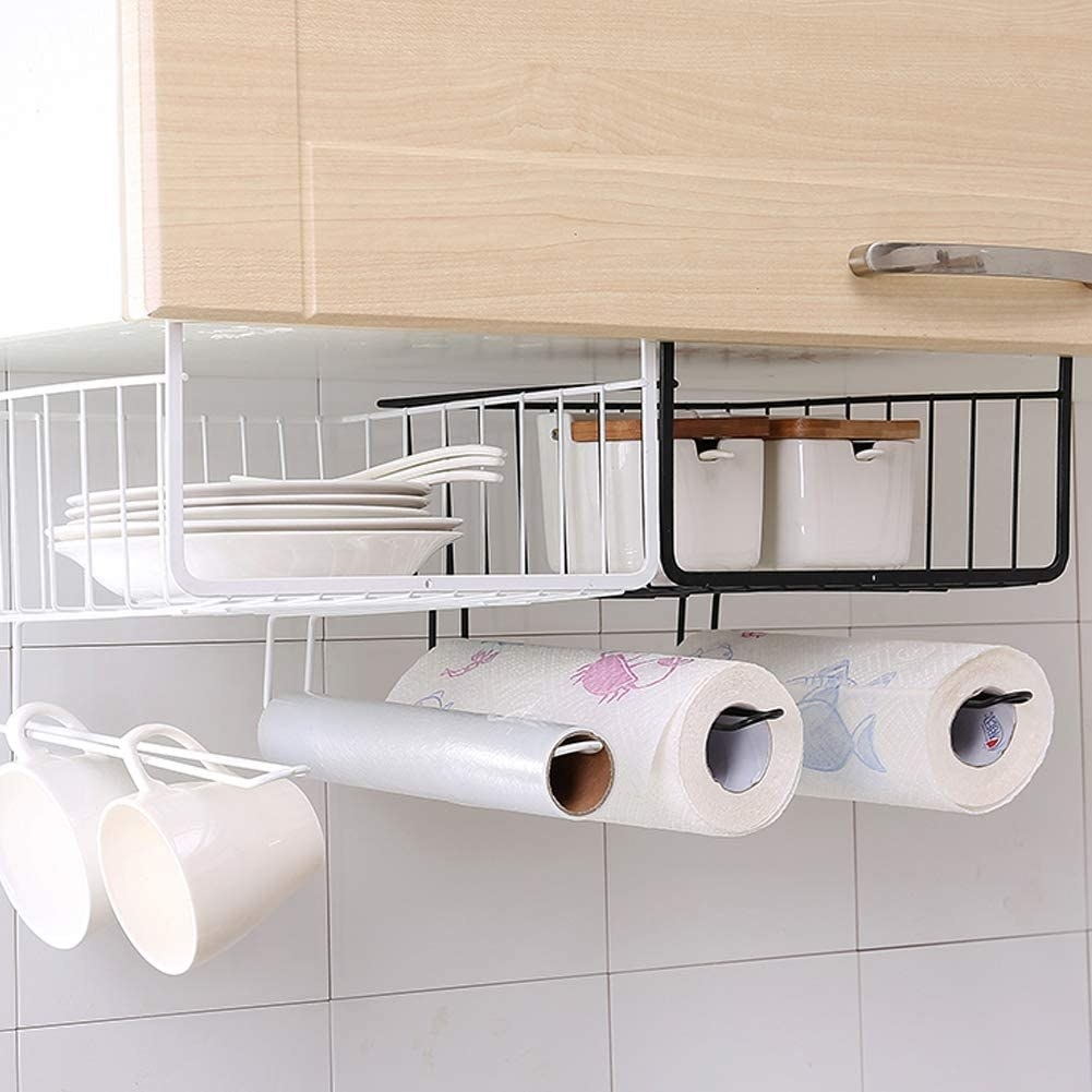 two under-shelf baskets filled with dishware