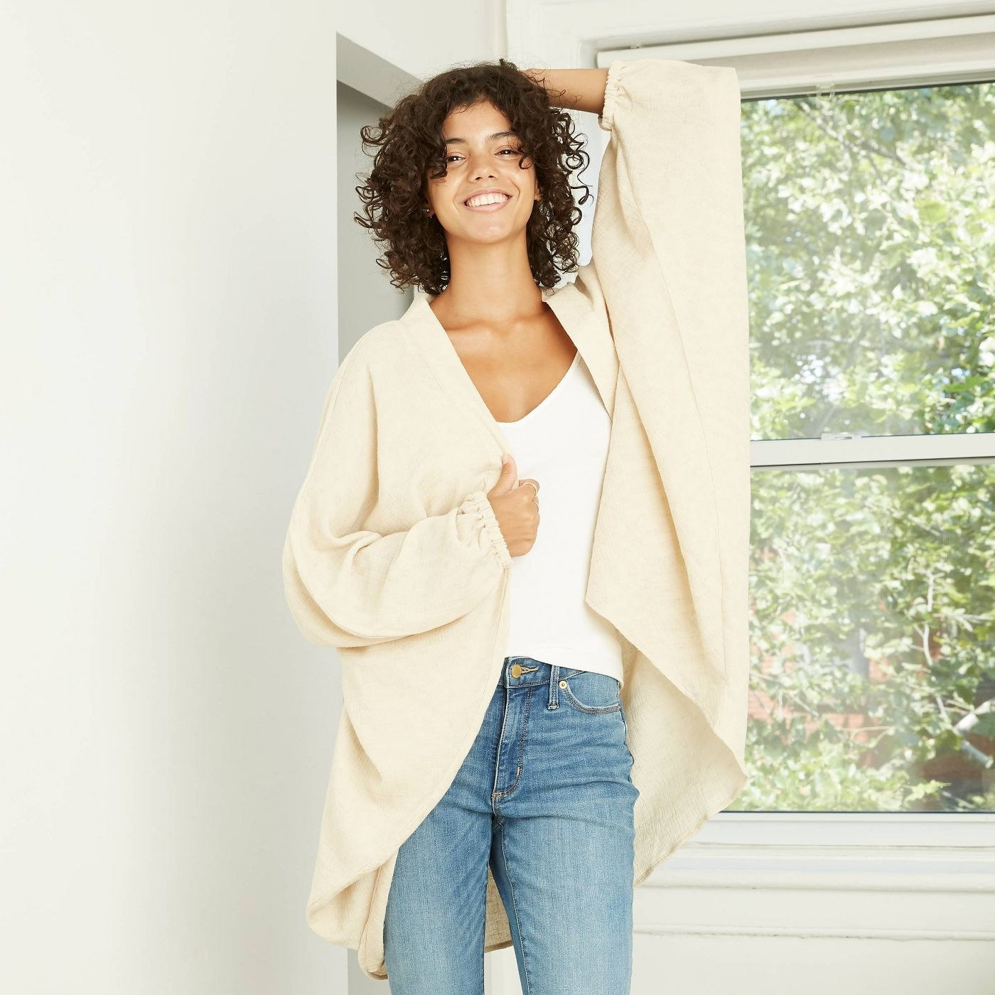 Model in oversized cream cocoon jacket