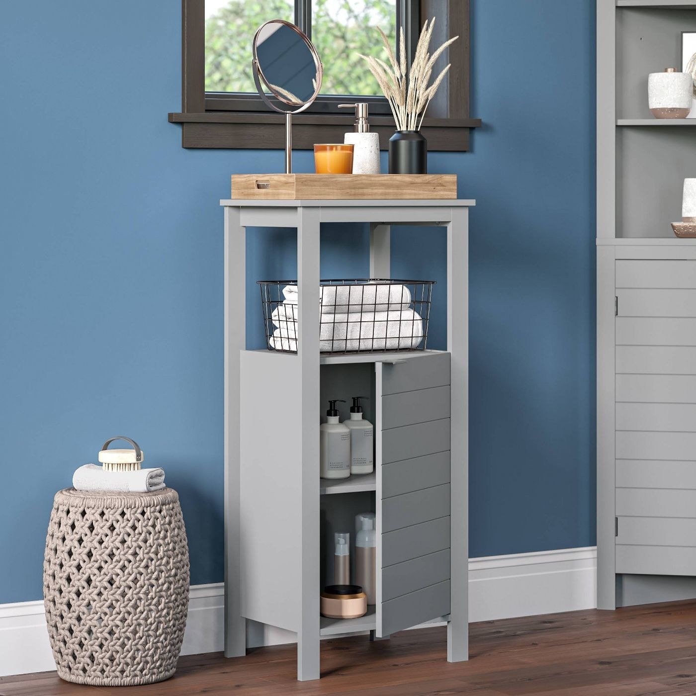The gray single door cabinet
