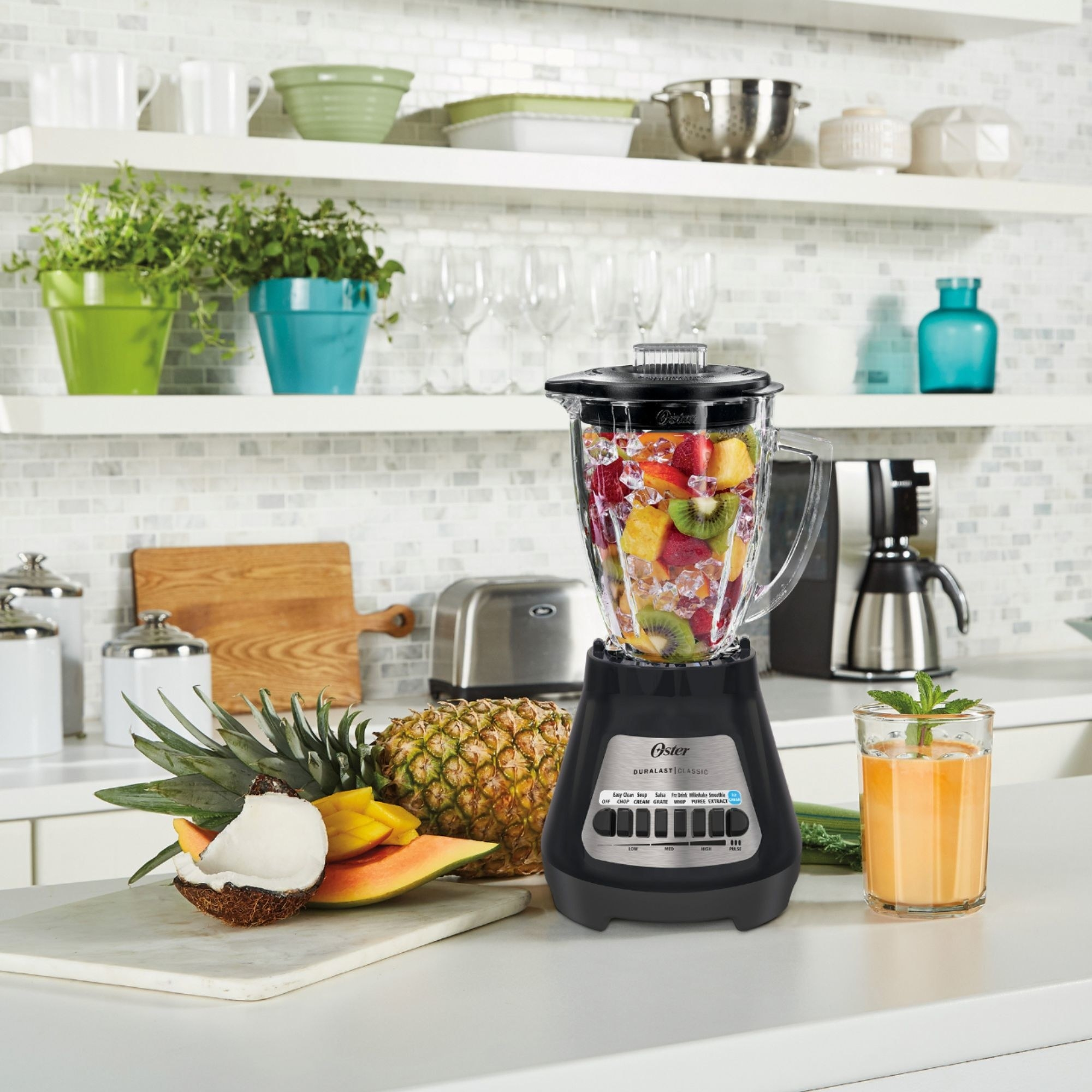 The blender mixing together ice and fruit