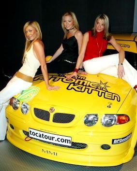 three women sat on yellow car