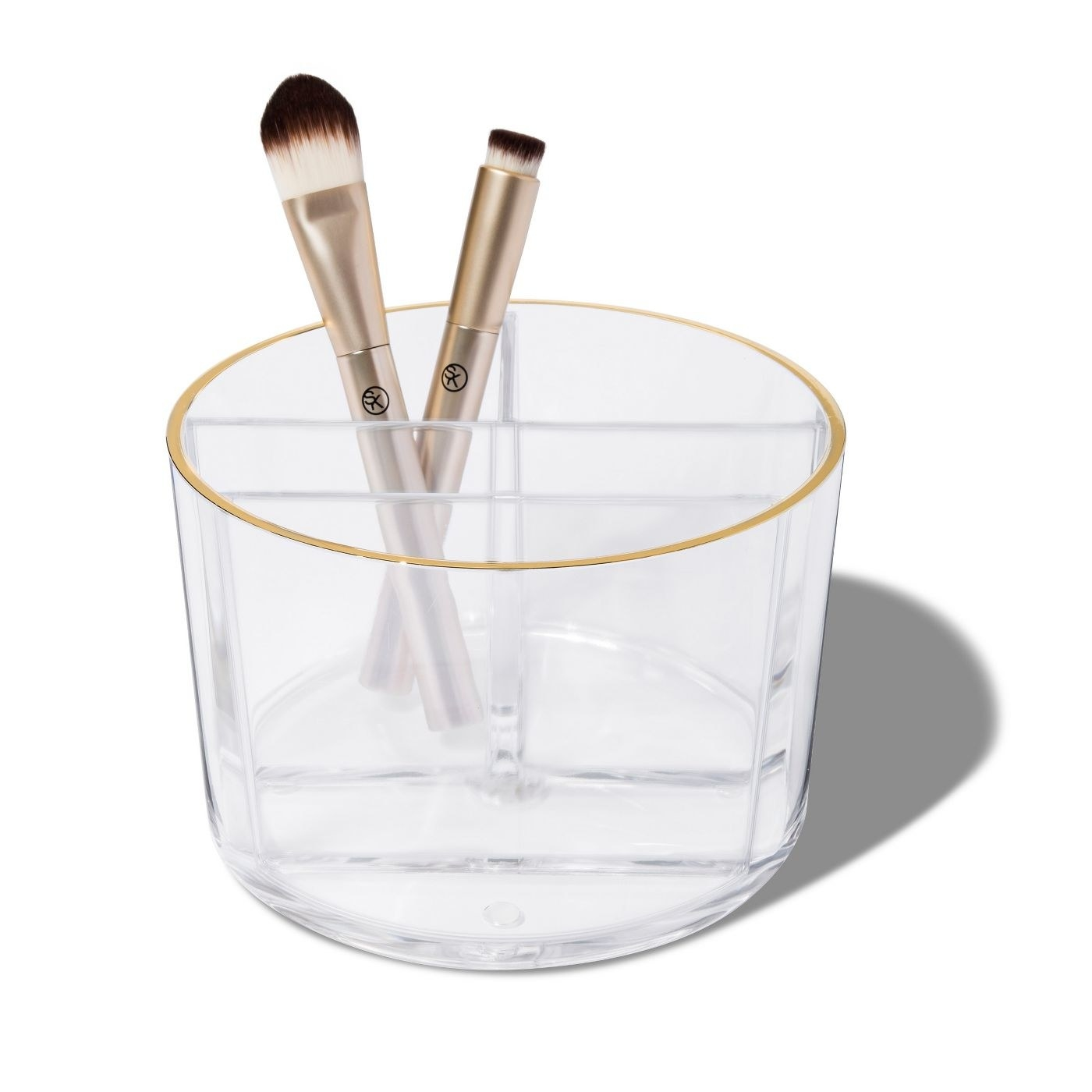The clear makeup brush holder with gold rim