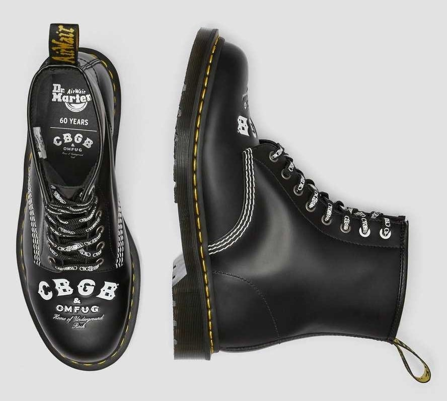 "the black boots with white text on toe labeled ""CBGB"""