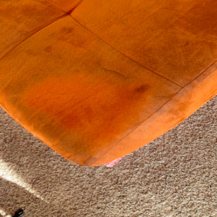 reviewer pic of brown suede couch cleaned with the cleaner