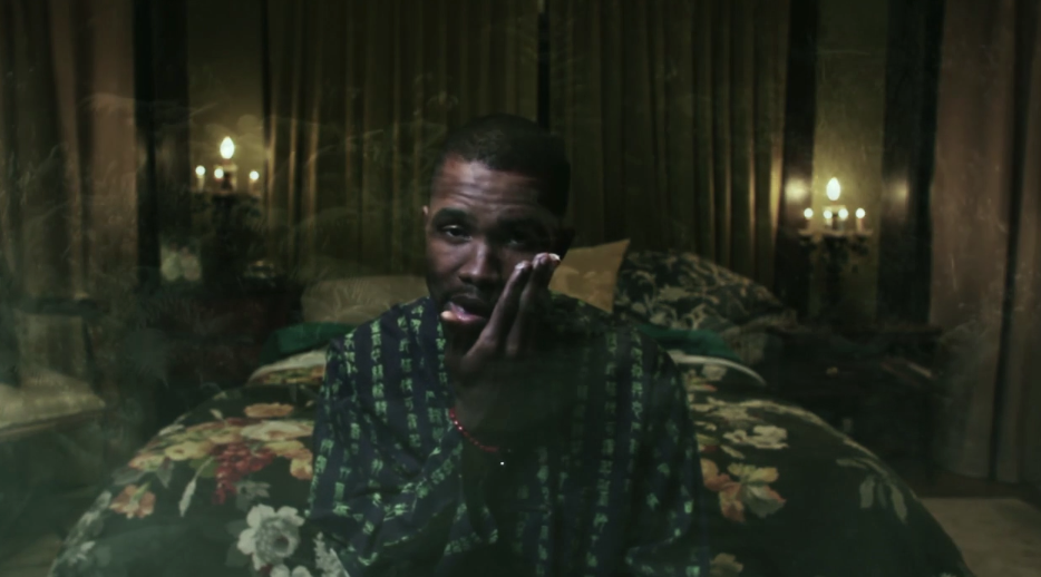 "Frank Ocean sitting on a bed in the ""Novacane"" music video"